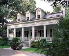 A lowcountry cottage designed by Historical Concepts, award-winning architects who specialize in designing traditional homes. This white house with a deep front porch and black shutters exemplifies classic Southern style. This is my dream home! Style At Home, Historical Concepts, Black Shutters, Louvered Shutters, White Siding, Traditional Exterior, Traditional Homes, Southern Homes, Southern Charm