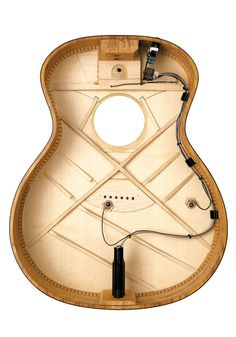 Bracing of a Taylor Guitar.... wish my luna was like this... The cable is not secured at all it just kinda flops around, messing me up when I plug in....