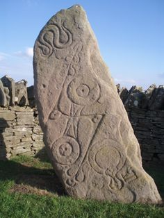 The Aberlemno Serpent Stone, Carved with the unique symbols of the Picts one of the 2 peoples that dominated Scotland in the Iron age. Images here include the snake, bent spear, roman mirror and the two disc's.  Scotland