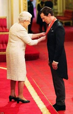 Receiving his CBE from Her Majesty the Queen at Buckingham Palace 10th November 2015
