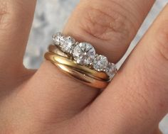 5 stone engagement with cartier trinity rolling ring wedding band. Looking fresh in this winter weather.