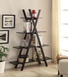 "The Oxford ""A"" Frame Bookshelf is a perfect addition to any home. Featuring 4 open shelves that will create a unique way to display everything from books to collectibles. Provides easy assembly. With the quality construction, it will be sure to provide years of enjoyment."