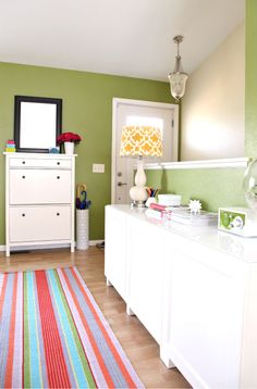 iHeart Organizing - entry way.  love wall color, shoe bin, dresser and lamp accent color