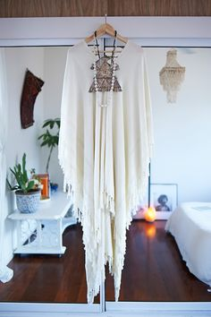 White fringed poncho