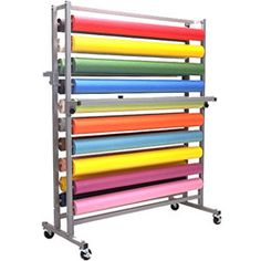 Roll dispensers, fabric roll dispensers, fabric unrollers, unrolling frames supplied by Ted Thorsen Material Handling Inc