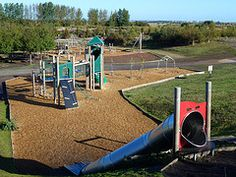 Cycling and playing at Fowlmead Country Park - Play Area