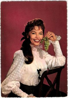 https://flic.kr/p/5CtaJu | Leslie Caron | German postcard by Krüger, nr. 902/35. Photo: Sam Lévin.  French film actress and dancer Leslie Caron (1931) was one of the most famous Hollywood stars in the 1950's. She is best known for the waif-like gamines in musical films like  Gigi (1958), Lili (1953), and An American in Paris (1951). Since the 1960's she's also working in the European cinema.  For more postcards, a bio and clips check out our blog European Film Star Postcards.