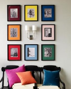 Multi color mats with identical frames with b/w pictues in a symmetrical arrangement