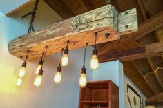 Create a unique look that transforms any space with the Farmhouse chandelier Farmhouse Chandelier Lighting, Rustic Lighting, Lighting Ideas, Industrial Chandelier, Modern Lighting, Bar Lighting, Pendant Lighting, Barn Wood, Rustic Wood