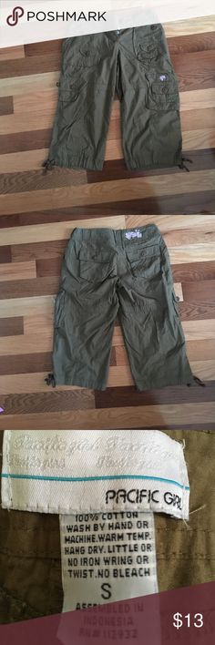 "Cargo Capris Sz S Waist 28.5."" Rise 8.5."" Inseam 19."" 6 posters on the front and two on the back. Fly buttons up with metal buttons and one plastic button. Wide belt loops including logo belt loop. One side zipper pocket. These are a swampy green. Pacific Girl Pants Capris"