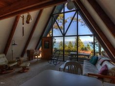 Living Room of Lakefront A-Frame in Montana >> http://www.frontdoor.com/coolhouses/tiny-house-tuesday-lakefront-a-frame-in-montana?soc=pinterest