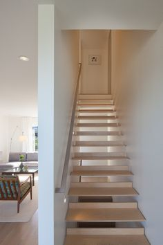 Modern Stairs // simple wood stairs with a brushed stainless steel handrail. Nice tread detail designed by Workshop AD Style Tudor, Tudor Style Homes, Wood Stairs, House Stairs, Contemporary Architecture, Architecture Details, Grand Stairway, Narrow House Plans, Stair Handrail