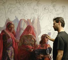 Scott Burdick working on his epic painting of a religious celebration in India.