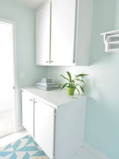 white painted laundry room cabinets copy