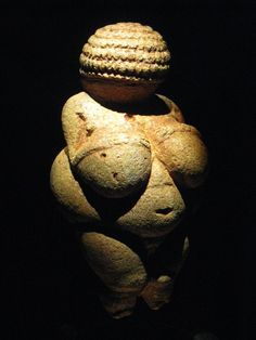 Venus of Willendorf --discovered in 1908  Willendorf,,  Austria. Limestone and tinted with red ochre 24,000 & 22,000 BC.