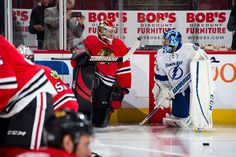 CHICAGO, IL - JANUARY 24: Goalies Scott Darling #33 of the Chicago Blackhawks and Ben Bishop #30 of the Tampa Bay Lightning warm up prior to the game at the United Center on January 24, 2017 in Chicago, Illinois. (Photo by Bill Smith/NHLI via Getty Images)