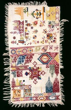 embroidery sampler (chelliga)  Nationality  Moroccan  Creation date  mid-1800s  Materials  cotton embroidered with silk and cotton  Dimensions  28 1/2 x 14 1/2 in.  Credit line  The Eliza M. and Sarah L. Niblack Collection  Accession number  33.252