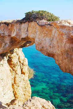 Bridge over turquoise water, Cavo Greco, Cyprus.