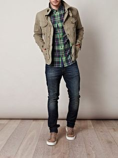 khaki sneakers, dark jeans, plaid shirt, khaki-colored canvas jacket outfit