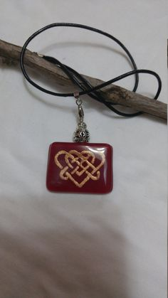Celtic love knot pendant. Bordeaux and gold pendant. Rectungle pendant. Celtic symbol. Women gift. Gift for mom. Mothers day gift. Chic love necklace ********************************************************************************************************************** Recently I was discovered the Celtic uniqe symbols. One of them is my favorite, The love knot . I choose for this pendant the combination between gold and Bordeaux and it looks so beautiful and chic. The necklace made of glass…
