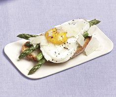 Asparagus and Fried Eggs on Garlic Toast recipe. The softly cooked egg yolks in this dish, which works well for breakfast, brunch, or a light dinner, become a delicious sauce for the toast and asparagus.