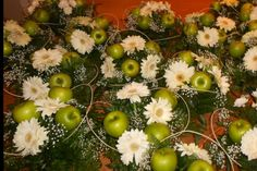 Green apples and daisies
