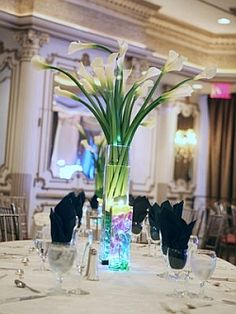 Calla lily wedding centerpiece with blue LED accent lighting.