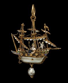Gold ship pendant, enamelled in white and green, the mother-of-pearl hull surmounted by three masts rigging and unfurled sails. On deck, guarded by cannons Venus is seated while her son Cupid, winged, stands behind her. A pearl hangs below the hull, as does the anchor. Suspension loop above. Second half of the 16th century.