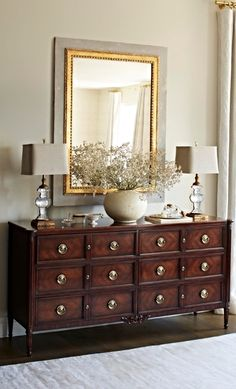 Louis XV styling in grand mahogany marks the Belcour Dresser with French Rococo flourishes: finely veneered drawer faces, an ornately carved bottom panel, fluted corner columns and cast-brass hardware. | Frontgate Interiors