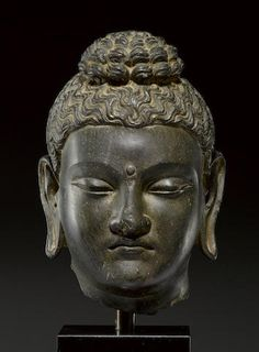 A schist head of Buddha Ancient region of Gandhara, 3rd/4th century