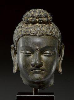 A schist head of Buddha Ancient region of Gandhara, 3rd/4th century