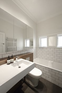 One of our client's new bathroom in Clovelly. Featuring our WESTMINSTER WHITE on the wall and CONTOUR CHARCOAL tiles on the floor.   http://www.skheme.com/Code.aspx?ID=CONTOUR%20CHARCOAL  http://www.skheme.com/Code.aspx?ID=WESTMINSTER%20WHITE  By One Up Building, Designer Andrea D'Cruz, Photo by Sharin Rees