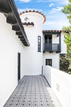 Fantastic cement tile used at a California Spanish style home exterior. Patio and front walkway makeover with on-trend tiles from the Cement Tile Shop. Cement Patio, Patio Tiles, Outdoor Tiles, Cement House, Balcony Tiles, Cement Tiles, House With Balcony, Deck Tile, Patio Wall