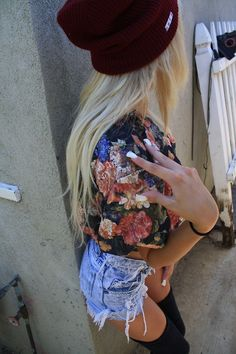 a cute summer outfit to walk around in. Note: -beanie hat -floral shirt -high wasted jeans -high socks