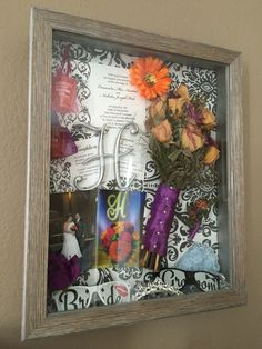 Antique Wedding Shadow Box. Includes wedding programs, dinner menu, wedding invitations, cake topper, something blue (lace linen from grandma), brides bouquet, grooms boutonniere, special photos, tiara & shot glasses inside glitter mesh as favors for the guests.