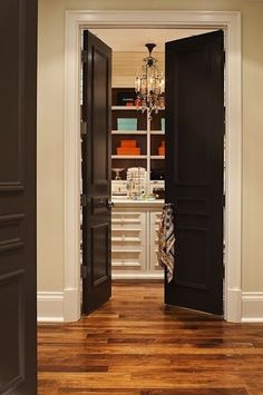 Dark doors with light trim and wood floors! Maybe even dark wood doors