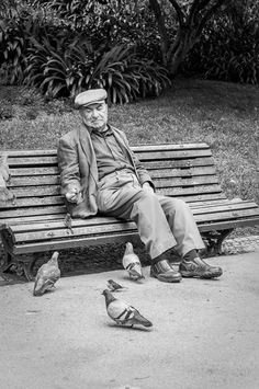 Communion: This man wanted to feed the sparrows and kept shooing the pigeons away. Eventually a tiny sparrow hovered at his hand and ate