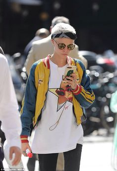 640af7e00d4866 Chilling out  Cara Delevingne put on a typically edgy display in a brightly coloured  bomber jacket and oversized T-shirt as she walked through Paris