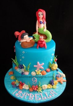 Disney Themed Cakes - This cake was made for Isabella who is turning 9 and is having a My Little Mermaid themed party. Her dad wanted a 2 tier cake for her with Ariel, Melody, Sebastian and Flounder on the cake (along with all the sea decorations of course!)    Isabella's reaction was priceless - she was so excited by her cake! I hope you had a fantastic birthday party today! :)