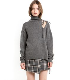 Watch Out! This Classic Sweater Just Got an Alluring Makeover via @WhoWhatWearUK