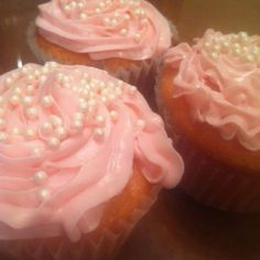 pink lemonade cupcake. pink piped buttercream frosting. white pearls for a decorative touch.