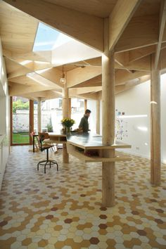 Tree-like columns support roof of Ghent house extension by Atelier Vens Vanbelle