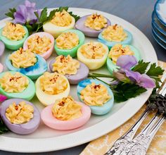Dyed Deviled Eggs, for Easter or for Fun!!  **to dye eggs, hard boil like normal and de-yoke.  Add to Bowls of water with food coloring in them and let soke for about 5 mins.  Take out and lay upside down on a paper towel and let dry.  Once dry, fill with filling and enjoy**