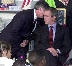 The 50 Most Powerful Pictures In American History President Bush's Chief of Staff Andy Card whispers into the ear of the president to give him word of the plane crashes into the World Trade Center, during a visit to the Emma E. Booker Elementary School in Iconic Photos, Rare Photos, Cool Photos, Hidden Photos, Rare Images, Famous Photos, Rare Pictures, 11 September 2001, Moslem