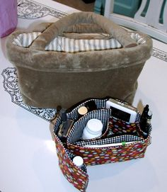 purse organizer that can lay flat or curl up inside your purse.