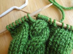 How to do a cable stitch for beginners. (...here we go...a new adventure, my knitting skills begin to grow!!)