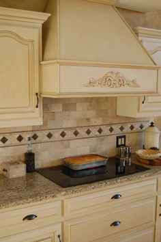Cream colored cabinets with Coffee Glaze