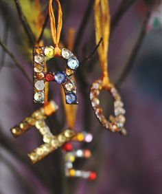 DIY: Custom glittering initial ornaments. Festive, personal, and inexpensive.