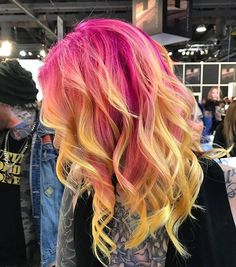 Pink roots and yellow ends. Love this bright ombre look!