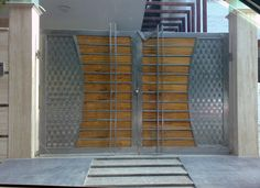 #Stainless_Steel_Toughened_Glass_Main_Gates and #Stainless_Steel_Wooden_Main_Gates_in_Delhi_Gurgaon_NCR #CallNow9818006283 Creative SS Fabrications